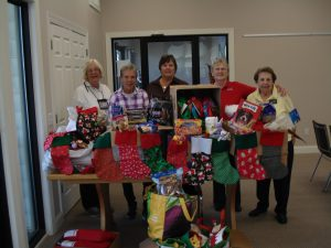 Volunteers (l. to r.) are ready to drop off the contributions from the community to the Stockings for Soldiers: Maureen Walker, Millville Volunteer Chairwoman Pat Moulder, Kathy Morrison, Maggie King, and Trudi Lombardi